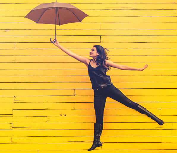 How to be bold and confident. Happy umbrella girl jumping. Blog article by RebeccaRoberts.com